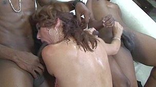 Kinky housewife engulfing 2 hard black knobs