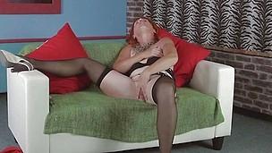 mature redhead has her favorite fake penis