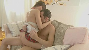Woman in checked school uniform climbs on a cock
