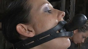 This skimpy woman getting her mouth jammed with the weird fucktoy
