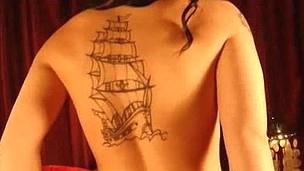 Watch Christy Macks large titties and tattoos.