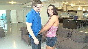 Short haired cutie with big tits is doing hand job indoors
