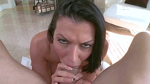 Pierced lady with black hair is fingering her shaved slit